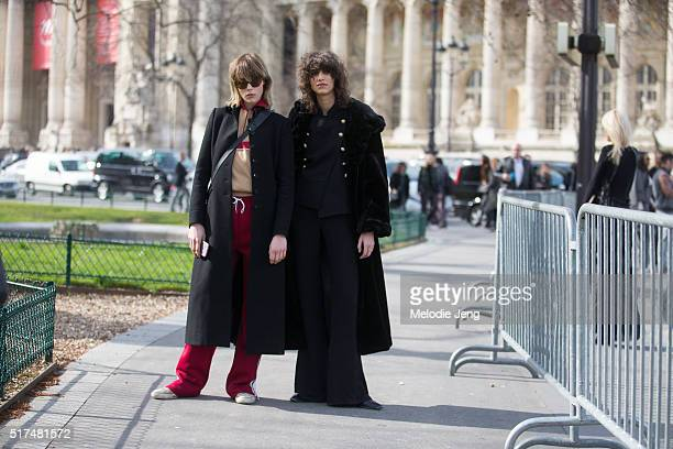 Models Mica Arganaraz and Edie Campbell exit the Chanel show at Grand Palais on March 07 2016 in Paris France Mica wears an all black outfit with a...