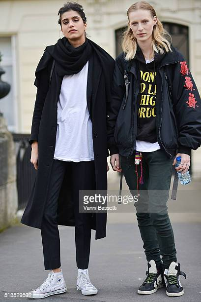 Models Mica Arganaraz and Julia Nobis pose after the Paco Rabanne show at the Musee d'art Moderne during Paris Fashion Week FW 16/17 on March 3 2016...