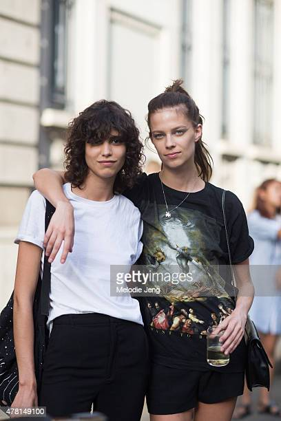 Models Mica Arganaraz and Lexi Boling exit the Prada show on June 21 2015 in Milan Italy