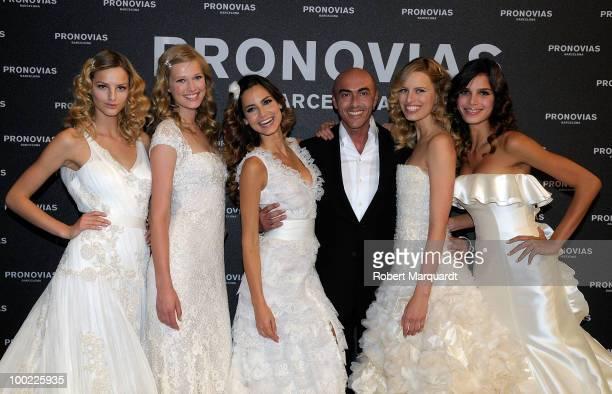 Models Micaela Kocianova Valentina Zalyaeva Ariadne Artiles designer Manuel Mota Karolina Kurkova and Raica de Oliveira present a creation from...