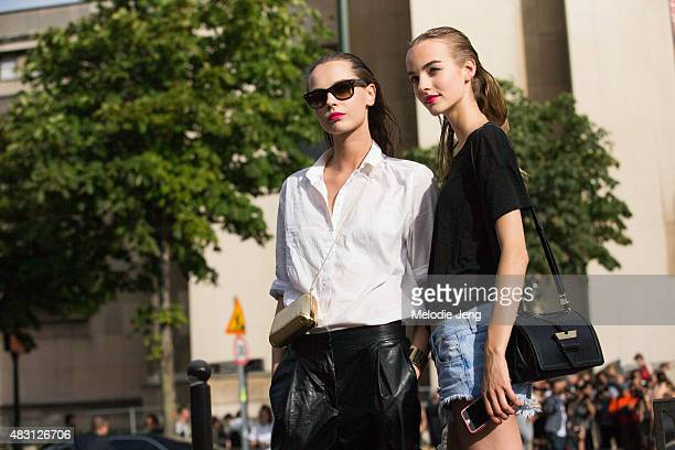 Models Mina Cvetkovic and Maartje Verhoef exit the Armani Prive show at Trocadero on July 7 2015 in Paris France Makeup by Linda Cantello Mina wears...