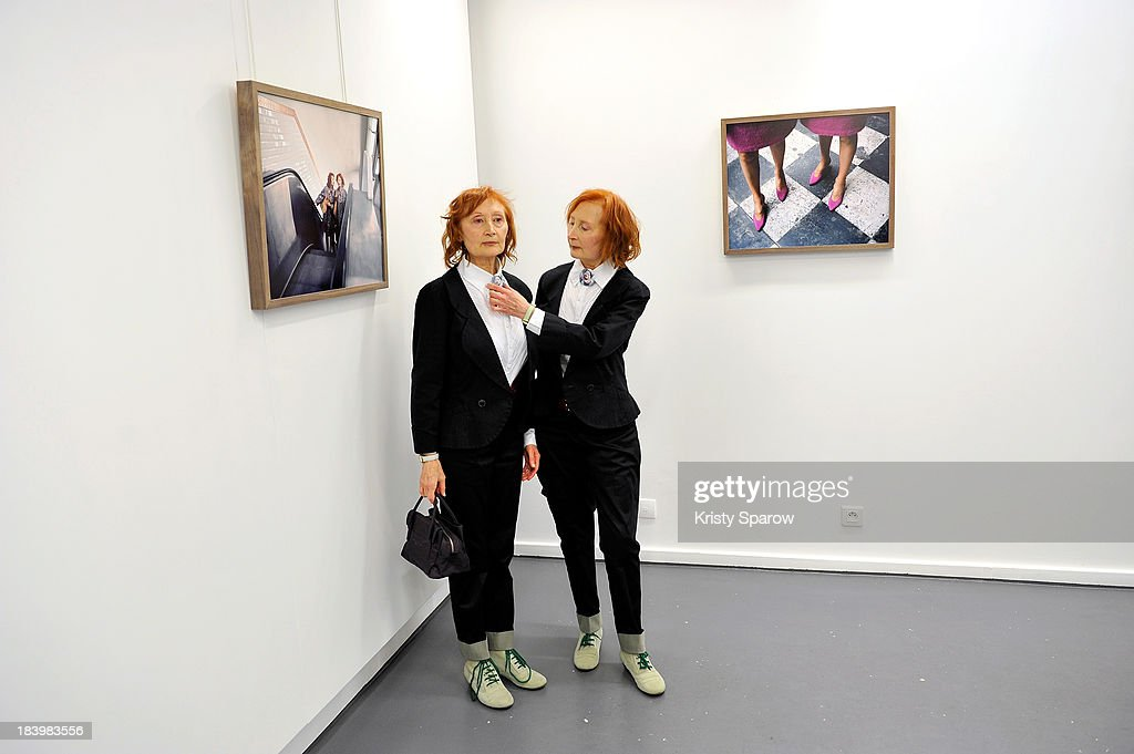 Models Monette Malroux and Mady Malroux are seen during Contour by Getty Images at Polka Gallery in Paris for Maja Daniels exhibition on October 10, 2013 in Paris, France.