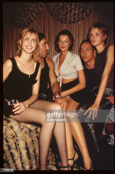 Models Nadja Auermann Teresa Maxova Trish Goff and designer Victor Alfaro sit November 3 1995 in New York City Model Amber Valletta recruited several...
