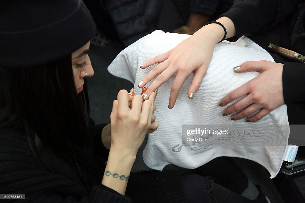 A models nails are prepared backstage at the Karigam Fall 2016 fashion show during New York Fashion Week: The Shows at The Space, Skylight at Clarkson Sq on February 12, 2016 in New York City.