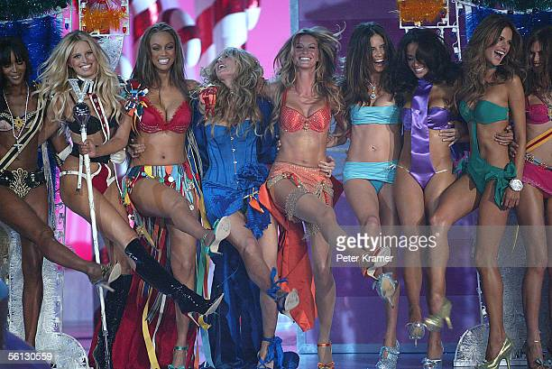 Models Naomi Campbell Karolina Kurkova Tyra Banks Heidi Klum Gisele Bundchen Adriana Lima Selita Ebanks and Alessandra Ambrosio pose on the runway at...