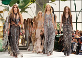 Models Natalia Vodianova and Laetitia Casta walk down the runway during the Roberto Cavalli Milan Fashion Week Womenswear S/S 2011 show on on...