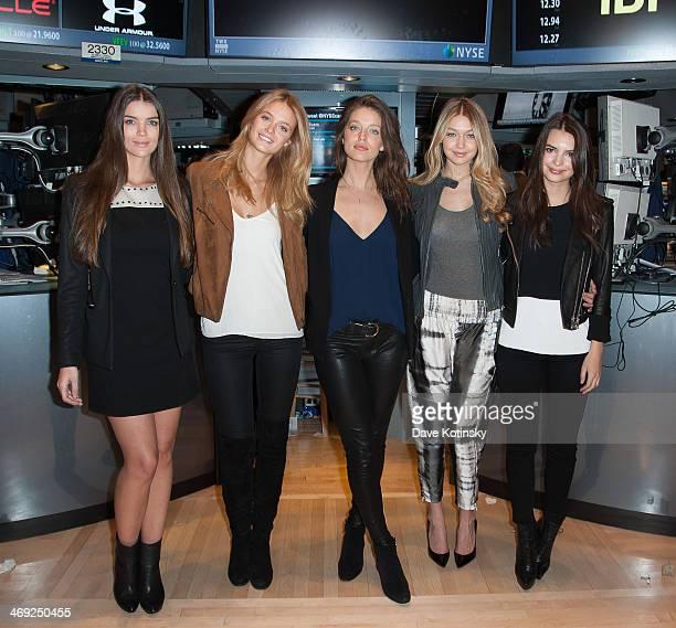 Models Natasha Barnard Kate Bock Emily DiDonato Gigi Hadid and Emily Ratajkowski ring the closing bell at New York Stock Exchange on February 13 2014...