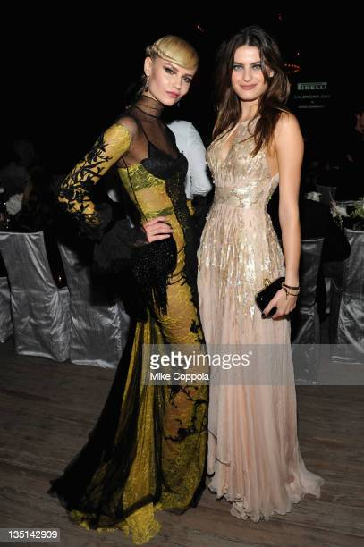 Models Natasha Poly and Isabeli Fontana attend the celebration of the global launch of the 2012 Pirelli Calendar By Mario Sorrenti gala dinner at the...