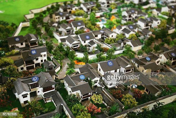 Models of a property development project are displayed at a real estate fair on May 3 2005 in Shanghai China According to a State Council executive...