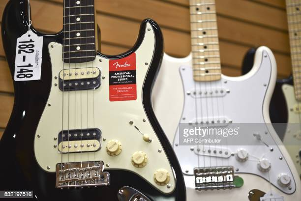 Models of American Professional Series guitars made by US manufacturer Fender are displayed at the Custom Shop of Holocausto Audio Iluminacion...