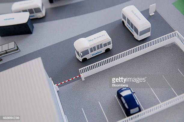 Models of Autolib's electric Bluebus and Bluecar sit at the Autolib carsharing headquarters in Vaucresson France on Monday March 9 2015 Vincent...