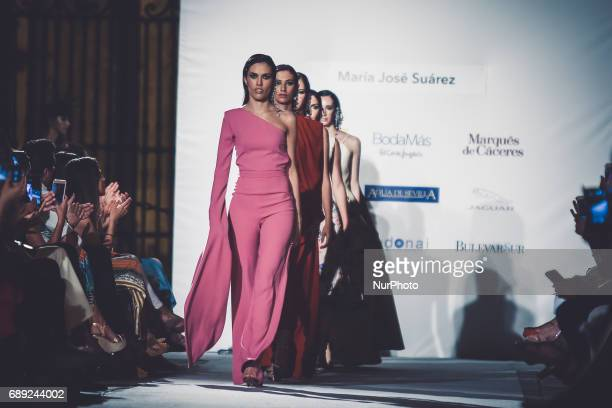 Models of Maria Jose Sarez walks on the catwalk in Seville on May 26 2017