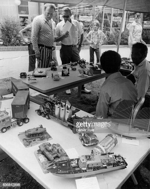 Models of Perfection Dan Jones standing left and Ciff Davis holding paper members of the International Plastic Modelers Society judge entries in the...