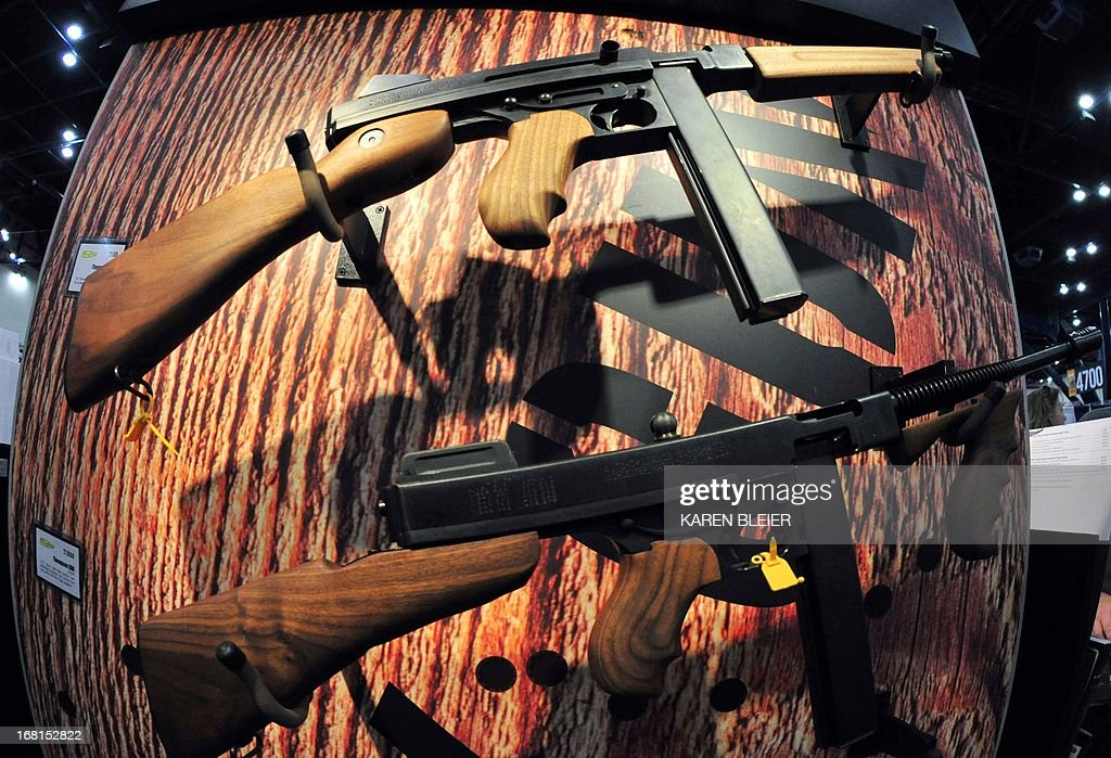 Models of the Thompson .45 submachine gun are seen at the 142nd annual National Rifle Association(NRA) Convention at the George R. Brown Convention Center May 4, 2013 in Houston, Texas.The Thompson was also known informally as: the 'Tommy Gun', 'Trench Broom', 'Trench Sweeper', 'Chicago Typewriter', 'Chicago Piano', 'Chicago Style', 'Chicago Organ Grinder', and 'The Chopper'. AFP PHOTO / Karen BLEIER