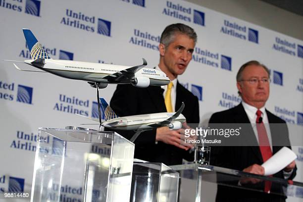Models of United Airlines jets with Continental Airlines logos are displayed during a press conference as Glenn Tilton chairman president and CEO of...
