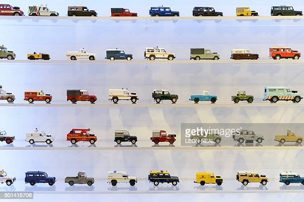 Models of varying incarnations of Land Rover Defender offroad vehicles are displayed during an exhibition to promote the forthcoming charity auction...