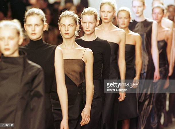 Models on the runway at the finale of the Calvin Klein Fall/Winter 1999 Fashion Show in New York City February 19 1999