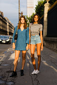 Models Ophelie Guillermand and Cindy Bruna exit the Alexandre Vauthier show at Les Arts Decoratifs on July 7 2015 in Paris France