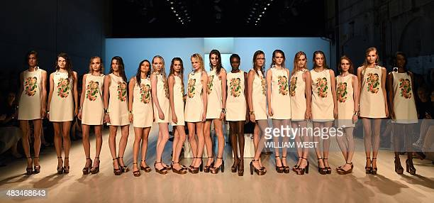 Models parade an outfit by Australian designer Jayson Brunsdon at Fashion Week Australia in Sydney on April 9 2014 The fourday schedule will include...