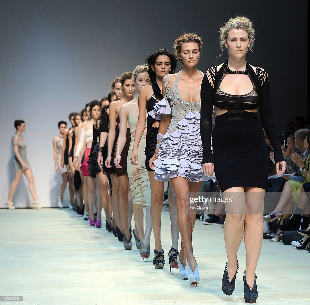 Models parade down the catwalk during the Mark Fast fashion show at the Topshop Venue University of Westminster on September 19 2009 in London England