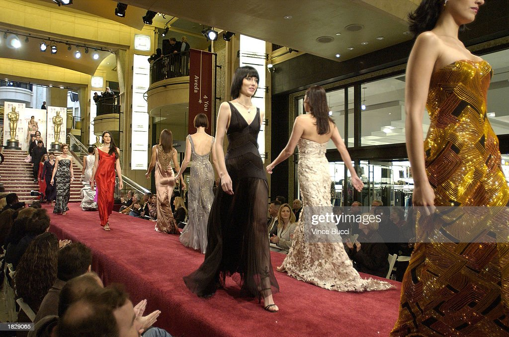 Models parade down the runway at the conclusion of the 2003 Oscar Fashion Preview at the Kodak Theatre on March 4, 2003 in Hollywood, California.