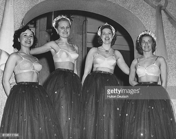 Models parade embroidered net and batiste brassieres at a show of undergarment fashions from the spring collection of corseters Berlei UK Limited...