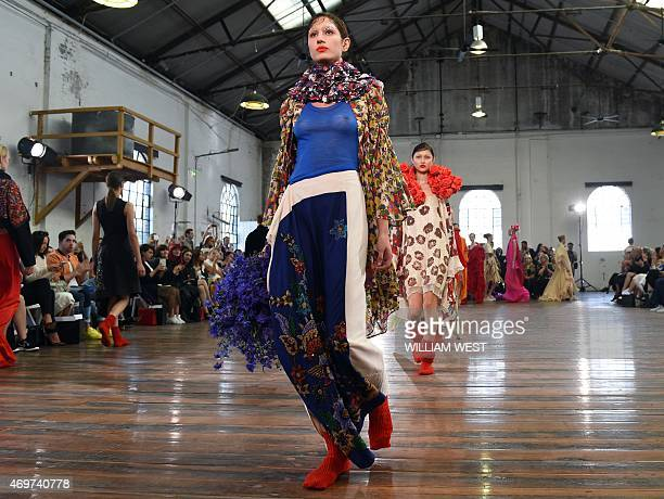 Models parade garments by Australian designer Akira Isogawa during Fashion Week Australia in Sydney on April 15 2015 AFP PHOTO / William WEST
