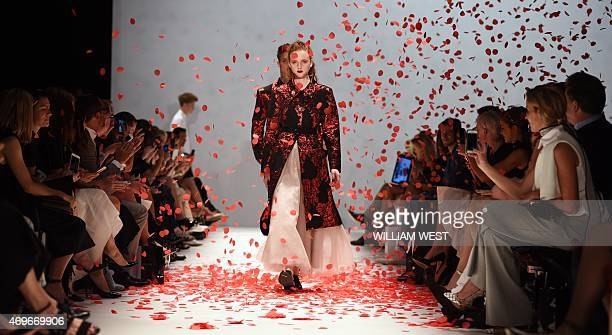 Models parade garments by Australian designer Jayson Brunsdon during a parade at Fashion Week Australia in Sydney on April 14 2015 AFP PHOTO /...