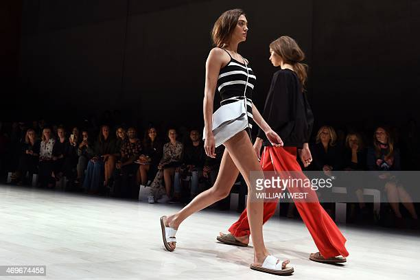 Models parade garments by Australian designer Lee Mathews during Fashion Week Australia in Sydney on April 14 2015 AFP PHOTO / William WEST