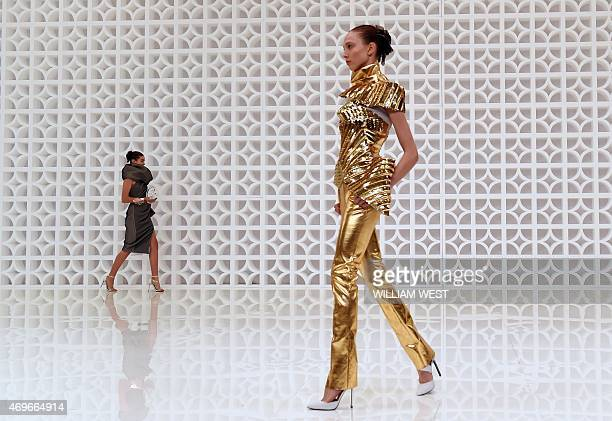 Models parade outfits by Australian label Maticevski at Fashion Week Australia in Sydney on April 14 2015 AFP PHOTO / William WEST