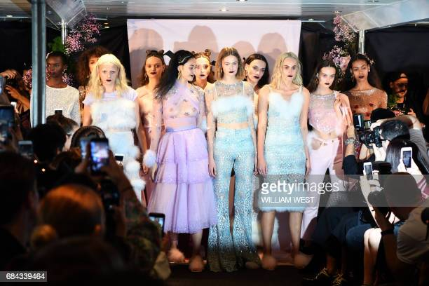 Models parade outfits by fashion label Dyspnea during Fashion Week Australia in Sydney on May 18 2017 / AFP PHOTO / William WEST