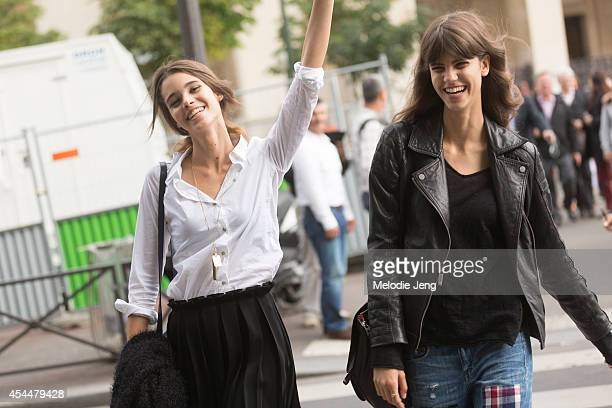 Models Pauline Hoarau and Antonina Petkovic after Armani Privee on Day 3 of Paris Haute Couture Fashion Week Autumn/Winter 2014 on July 8 2014 in...