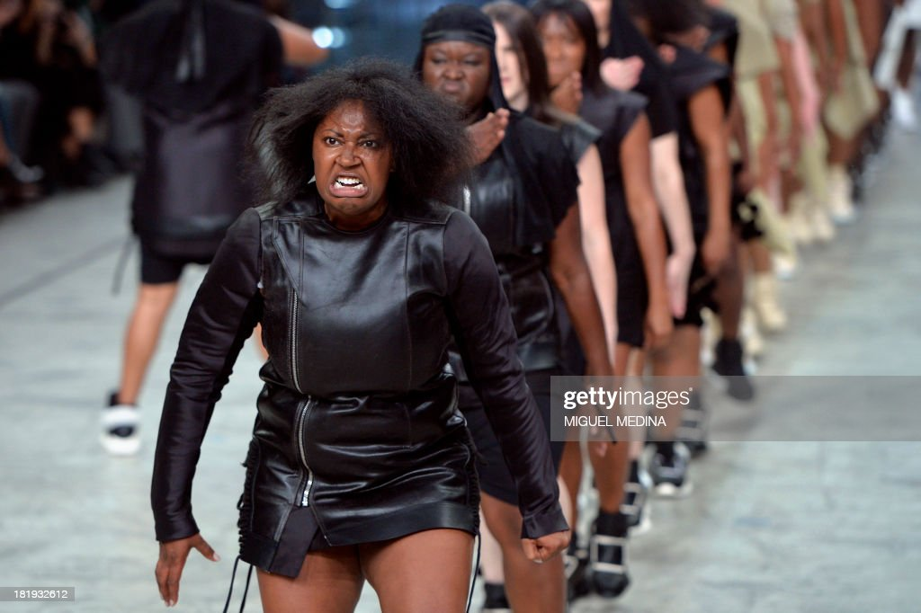 Models perform as they present creations by Rick Owens during the 2014 Spring/Summer ready-to-wear collection fashion show, on September 26, 2013 in Paris.