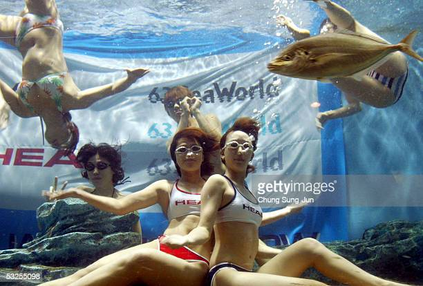 Models perform in a swimsuit fashion show in an aquarium on July 19 2005 in Seoul South Korea The event was hosted by South Korea's fashion company...