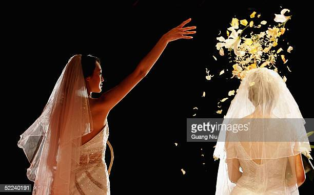 Models performs during a wedding fashion show on February 25 2005 in Beijing China China's state media recently reported that modern Chinese couples...