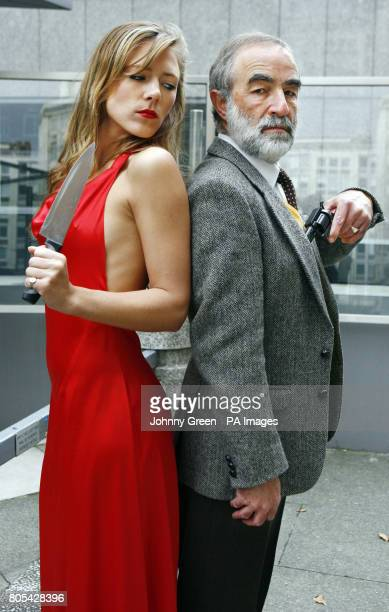 Models playing the roles of Cluedo characters Miss Scarlet and Colonel Mustard celebrate Cluedo's 60th anniversary outside the headquarters of the...