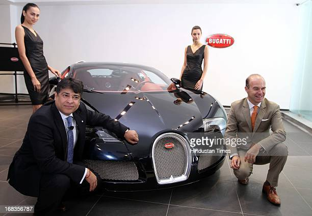 Models pose as Exclusive Motors Managing Director Satya Bagla with Bugatti Sales and marketing manager Europe Middle East and India Guy Caquelin...