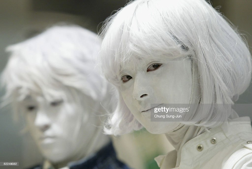 Models pose as mannequins during a promoton for new spring collections in a departement store on February 27, 2005 in Seoul, South Korea.