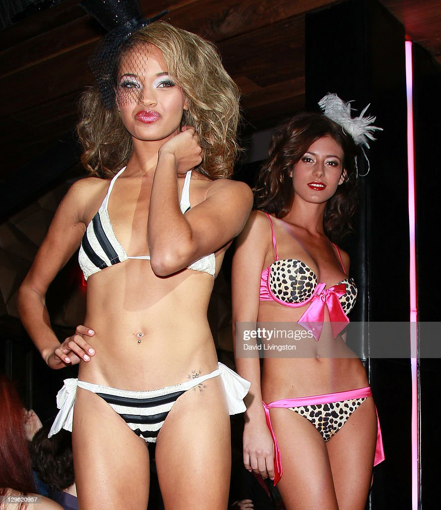 Models pose at Beach Bunny Swimwear's celebration of LA Fashion Week at Eden on October 18, 2011 in Los Angeles, California.
