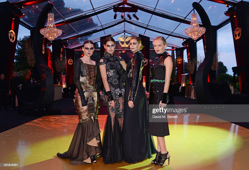 Models pose at Lionsgate's 'The Hunger Games: Mockingjay Part 1' party at a private villa on May 17, 2014 in Cannes, France.