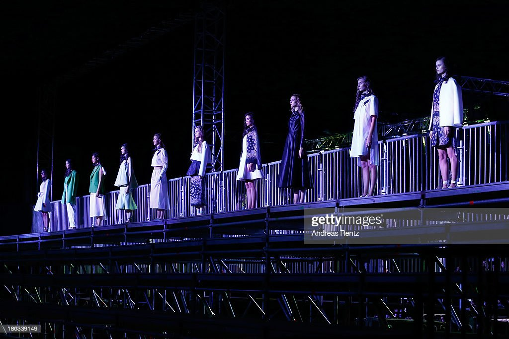 Models pose at the BEssARION show during Mercedes-Benz Fashion Week Russia S/S 2014 on October 30, 2013 in Moscow, Russia.