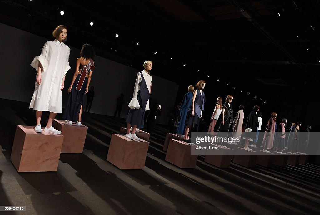 Models pose at the Claudia Li presentation during New York Fashion Week Women's Fall/Winter 2016 at ArtBeam on February 10, 2016 in New York City.