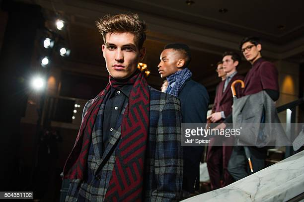 Models pose at the Duchamp presentation during The London Collections Men AW16 at The Rosewood Hotel on January 10 2016 in London England