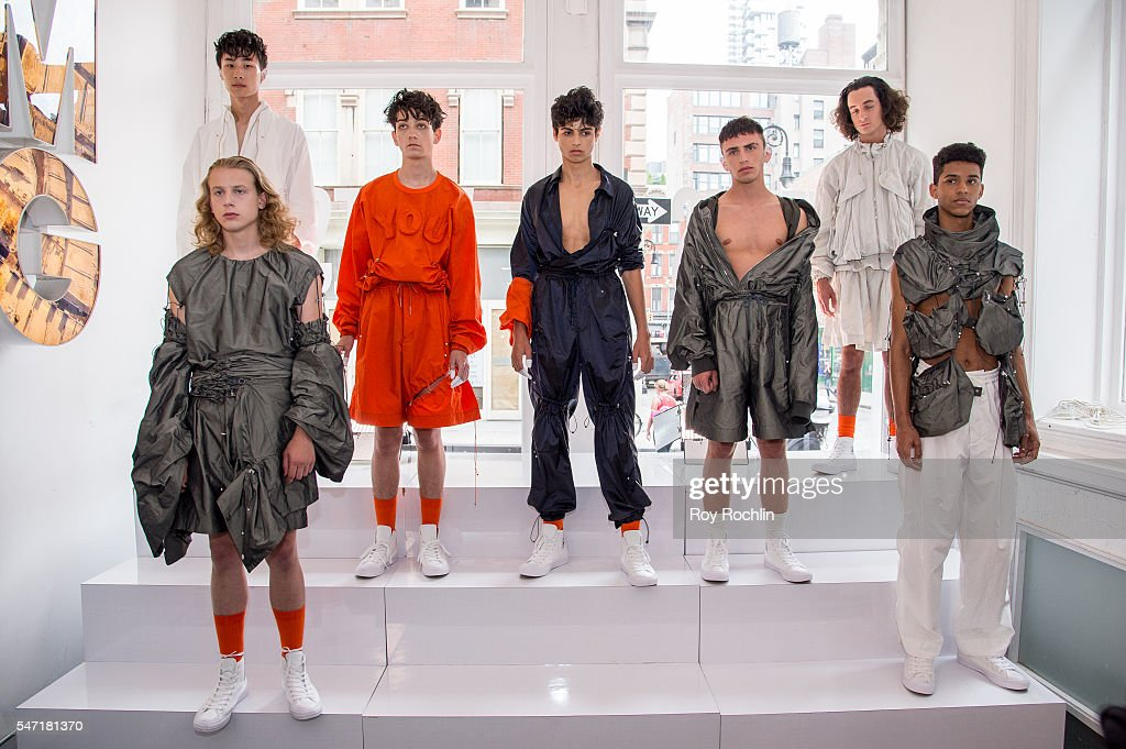 Models pose at the Feng Chen Wang presentation during New York Fashion Week Men's S/S 2017 on July 13 2016 in New York City