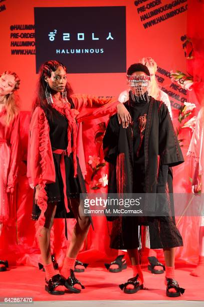Models pose at the Haluminous presentation during the London Fashion Week February 2017 collections on February 19 2017 in London England