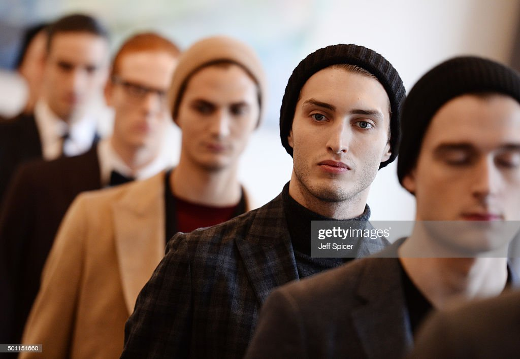Models pose at the Hardy Amies presentation during The London Collections Men AW16 at The Arts Club on January 9 2016 in London England