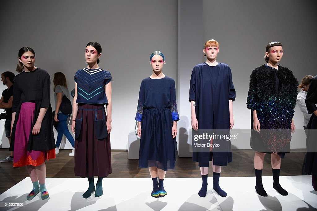 Models pose at the HFK Bremen (Acht. Graduate Show & Exhibition) show during the Mercedes-Benz Fashion Week Berlin Spring/Summer 2017 at Stage at me Collectors Room on June 29, 2016 in Berlin, Germany.