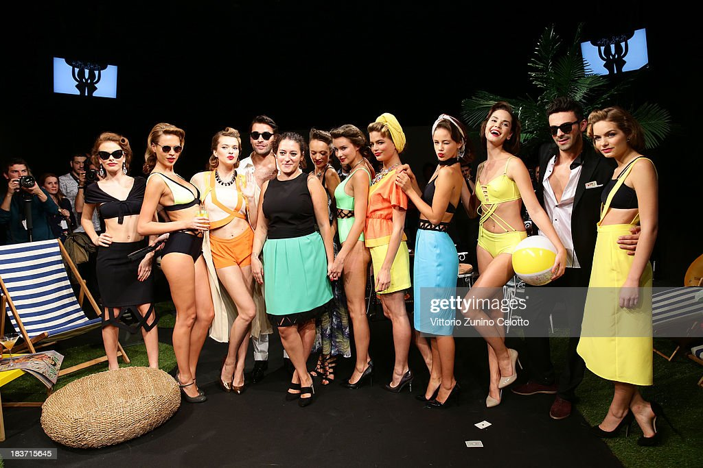 Models pose at the Kith & Kin show during Mercedes-Benz Fashion Week Istanbul s/s 2014 presented by American Express on October 9, 2013 in Istanbul, Turkey.