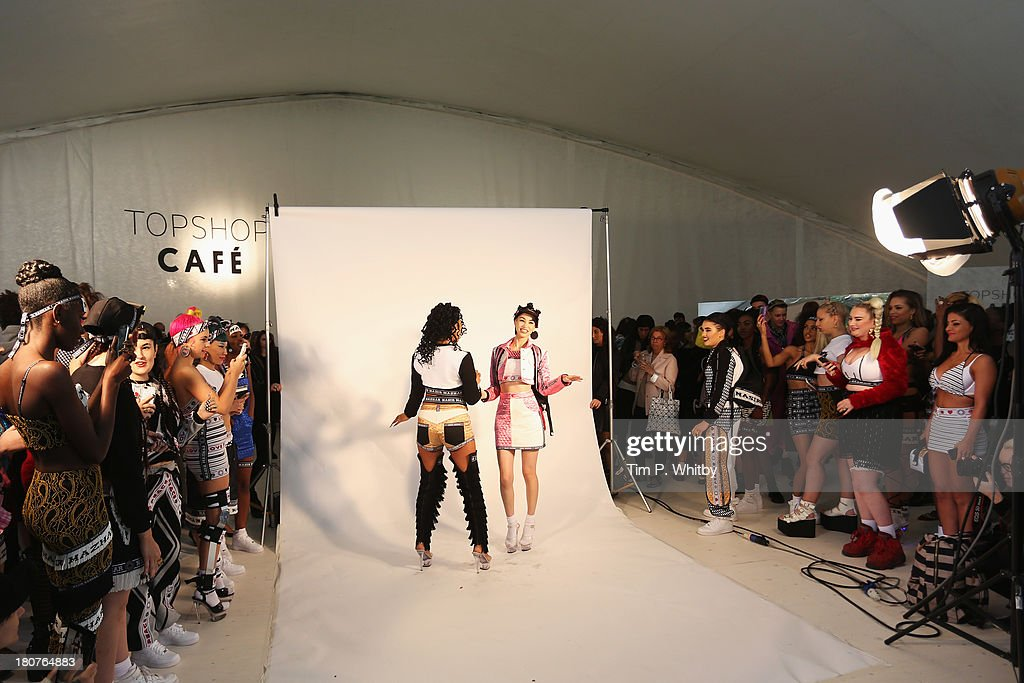 Models pose at the Nasir Mazhar presentation during London Fashion Week SS14 at TopShop Show Space on September 16, 2013 in London, England.