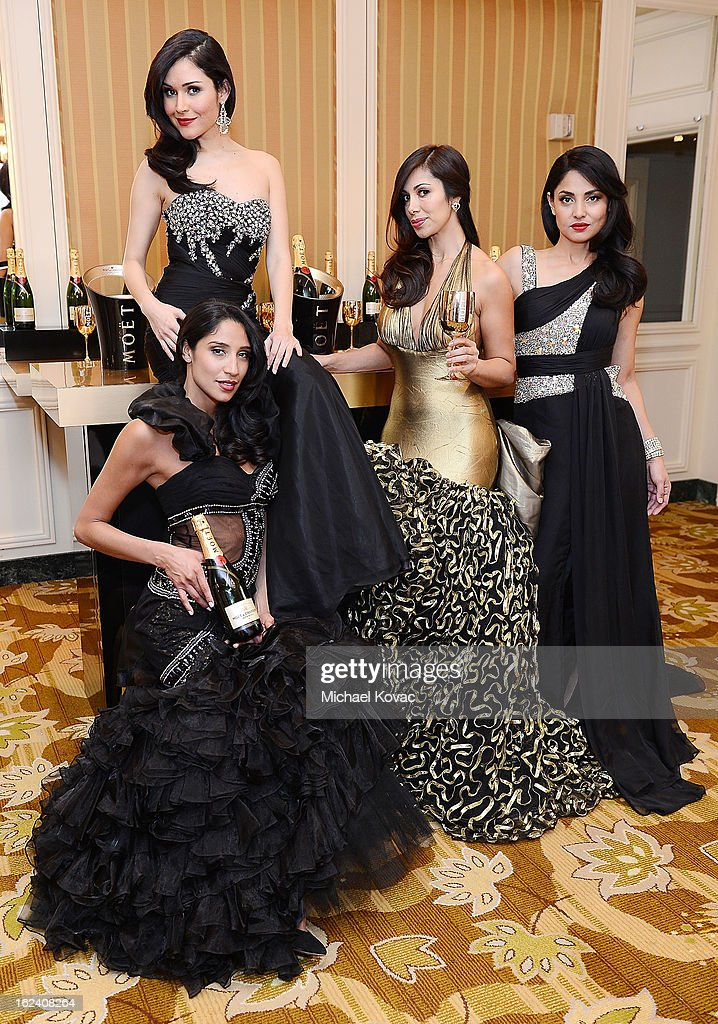 Models pose at The National Hispanic Media Coalition Impact Awards sponsored by Moet & Chandon at the Beverly Wilshire Four Seasons Hotel on February 22, 2013 in Beverly Hills, California.